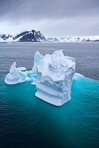 Aerial view of iceberg, with majority of berg visible under the water, Antarctic peninsula, February 2007 - Sue Flood