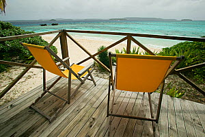 Two empty deckchairs on platform looking out to sea, Vavau islands, Kingdom of Tonga, South Pacific, September 2007  -  Sue Flood