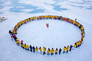Tourists standing in a circle around the North Pole, July 2008  -  Sue Flood