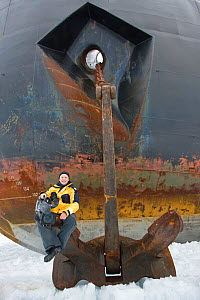 Cameraman Doug Allan, sitting on anchor of Russian nuclear icebreaker, NS 50 Lyet Pobyedi (50 years of Victory) en route to the North Pole, July 2008 - Sue Flood