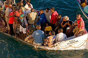 Over-loaded lifeboat close to sinking on Lake Malawi being used as a ferry from ship to shore, Malawi. March 2009  -  Will Watson
