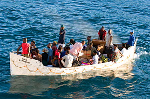 Over-loaded lifeboat from the Ilala on Lake Malawi being used as a ferry from ship to shore, Malawi. March 2009  -  Will Watson