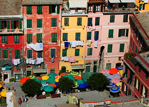 Piazza with colourful buildings and parasols, Vernazza, Cinque Terre, Italy, 2006.  -  Toby Roxburgh