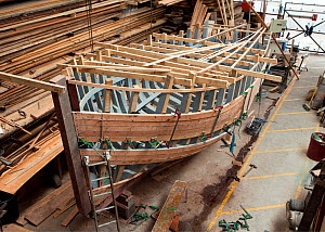 Wooden fishing boat under construction at the Underfall Yard, Bristol, England, UK, 2009.  -  Toby Roxburgh