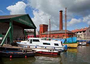 Underfall Boatyard workshop (to left), which houses experienced shipwrights, riggers, blacksmith and welders, fibre composite specialists and carpenters. Bristol, England, UK, 2009.  -  Toby Roxburgh