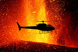 Helicopter flying over volcanic eruption near Eyjafjallajoekull glacier, Iceland, 24th March 2010. Volcano previously dormant since 1821.  -  Uri Golman