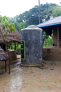 Water tank provided by Clean water project initiated by NGO, Uttaran, Ganges delta, Bangladesh, November 2008  -  David Woodfall