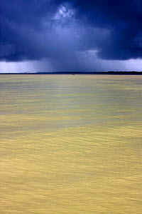 Dark monsoon rain clouds over the Pasur river, Ganges delta,  Bangladesh, November 2008 - David Woodfall