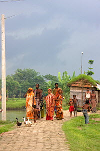 Villagers living in former river bed now dry due to siltation, complex effects of climate change, Ganges delta, Bangladesh, November 2008  -  David Woodfall