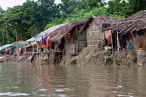 Homes threatened by rising sea levels, Passur river, Ganges delta, Bangladesh, November 2008 - David Woodfall