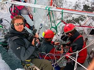 Chadden Hunter (cameraman) and film crew filming inside 'moulins', the ice caves that drain meltwater through glaciers, Gorner Glacier, Alps, Switzerland, October 2005.  Filming for the Mountains Epis...  -  Chadden Hunter