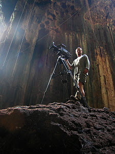 Ted Giffords (cameraman) filming bats and local Malaysian bird-nest collectors who risk their lives to collect swallows nests for birds nest soup, Gomantong Caves, Borneo, Malaysia, April 2004, filmin...  -  Chadden Hunter