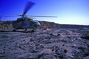 Film crew being dropped off by Ethiopian military helicopter beside the permanently bubbling Erta Ale lava lake, Erta Ale volcano, Danakil Desert, Ethiopia, November 2003.  Filming for the Mountains e... - Chadden Hunter