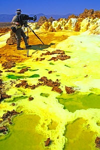 Martyn Colbeck filming the Dallol Hot springs, Danakil Desert (the world's hottest desert) Ethiopia, November 2003,  Filming for the Mountains episode of BBC NHU tv series, Planet Earth. Filming the o...  -  Chadden Hunter