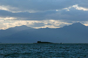 Submarine at surface in Avacha Bay, with Koryaksky / Koryakskaya  volcano (3,456m) in the distance, Petropavlovsk, Kamchatka, Russia, September 2006 - Patricio Robles Gil