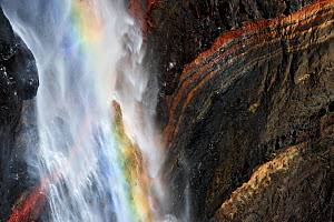 Rainbow in Hengifoss waterfall flowing over layers of grey basalt and reddish sandy clay, Iceland, August 2008  -  Wild Wonders of Europe / O. Haarberg
