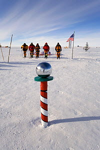 Norwegian group, 'Living the Dream' arrive at the Ceremonial Pole. South Pole, Antarctica, January 2006.  -  Bryan and Cherry Alexander