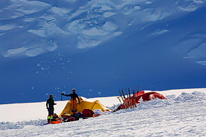Norwegian mountaineers and their tents at Mount Vinson Base Camp. Vinson Massif, Antarctica, January 2006.  -  Bryan and Cherry Alexander