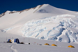 Icefall behind Vinson Base Camp, with tents in foreground. Vinson Massif, Ellsworth Mountains, Antarctica, January 2006.  -  Bryan and Cherry Alexander