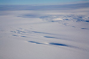 Crevasses in the Polar Plateau, partly covered in snow. Antarctica, January 2006.  -  Bryan and Cherry Alexander