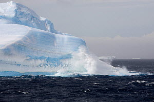 Waves break agains the bottom of a large iceberg on a stormy day in Erebus & Terror Gulf. Antarctic Peninsula, October 2006.  -  Bryan and Cherry Alexander