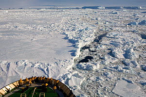 """Tourist on the bow of the """"Kapitan Khlebnikov"""" in pack ice in Erebus & Terror Gulf. Antarctica, October 2006.  -  Bryan and Cherry Alexander"""