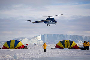 Russian Mi-2 helicopter by the safety tents at Snow Hill Island. Antarctica, October 2006.  -  Bryan and Cherry Alexander