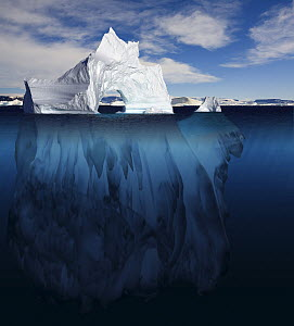 Ice arch iceberg showing the portion underwater that is sculpted by the sea. Polar regions. Digitally created image composite  -  Bryan and Cherry Alexander
