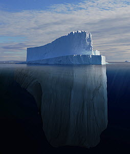 Tabular iceberg showing the portion underwater that is sculpted by the sea. Polar regions. Digitally created image composite  -  Bryan and Cherry Alexander