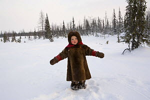 Komy girl, aged 2, playing in the snow at her family's winter camp. Yamal, Northwest Siberia, Russia, February 2007. Editorial use only.  -  Bryan and Cherry Alexander
