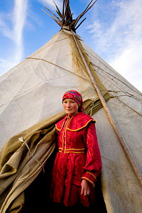 Khanty woman standing at the entrance to her family's tent in the Polar Ural Mountains, Yamal, Western Siberia, Russia, Summer 2007. Editorial use only. - Bryan and Cherry Alexander