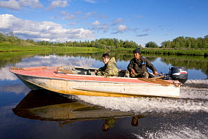 Selkup man and his son travelling by boat on the Puryakhar River near Bistrinka. Purovsky Region, Yamal, Western Siberia, Russia, August 2008. Editorial use only. - Bryan and Cherry Alexander