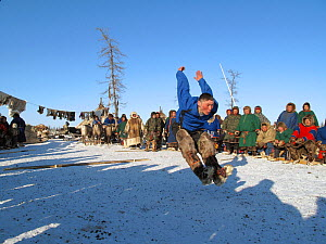 Nenets man competing in a long jump competition at a reindeer herders festival in the Yamal. Western Siberia, Russia, February 2009. Editorial use only.  -  Bryan and Cherry Alexander