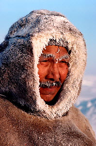 Inuk man from Igloolik with frozen snow on his face and clothing. Nunavut, Canada, 1990. Editorial use only. - Bryan and Cherry Alexander