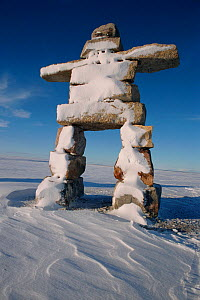 Large Inukshuk built at Igloolik in 2000 to commemorate the new millenium. Nunavut, Canada, 2002.  -  Bryan and Cherry Alexander