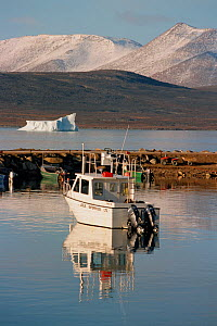 Boat in the harbour of the Inuit community of Qikiqtarjuaq (Broughton Island), Nunavut, Canada, 2002. - Bryan and Cherry Alexander