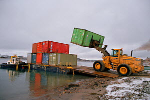 Containers of supplies being unloaded from a barge during sealift at Cape Dorset. Baffin Island, Nunavut, Canada, 2002.  -  Bryan and Cherry Alexander