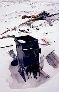 Electrical transformer, a source of PCBs, discarded by the US military at old DEW Line site on the Melville Peninsula. Nunavut, Canada, 1992. - Bryan and Cherry Alexander