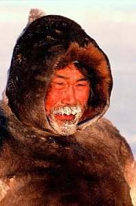 Inuit hunter with breath frozen into his beard in the cold. Igloolik, Nunavut, Canada, 1993 - Bryan and Cherry Alexander