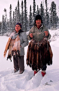 Cree trapper and wife with autumn catch of Pine martens (Martes martes), Quebec, Canada, 1988.  -  Bryan and Cherry Alexander