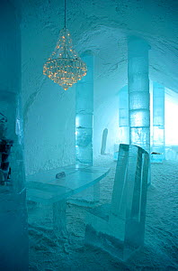 Chandelier hanging above ice table in the Ice Hotel. Jukkasjarvi, Sweden, 2003.  -  Bryan and Cherry Alexander