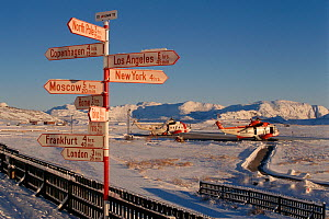 Sign at Greenland main international airport, Kangerlussuaq, Sondre Stromfjord, Greenland, with time taken to fly to various cities, 1996. - Bryan and Cherry Alexander