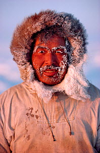 Inuit hunter with frozen hood and beard at minus 30 celsius. Northwest Greenland.  -  Bryan and Cherry Alexander