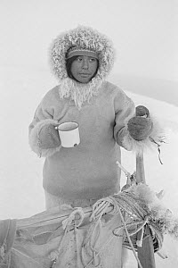 Inuk with mug of tea during break on hunting trip. Siorapaluk, Northwest Greenland, 1977. - Bryan and Cherry Alexander