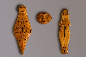 Ritual objects carved from Walrus ivory (circa 1000 BC - 1000 AD) Bering Strait, Chukotka, Siberia, Russia, 2004. - Bryan and Cherry Alexander