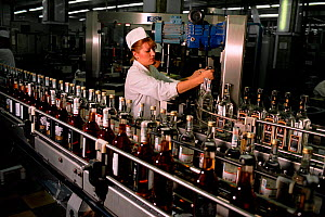 Russian women working on production line in Cristall Vodka Distillery in Moscow, Russia, 2003.  -  Bryan and Cherry Alexander