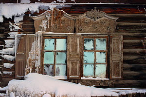 Frosted windows and carved wooden details on an old building in Yakutsk. Yakutia, Siberia, Russia, 1999. - Bryan and Cherry Alexander