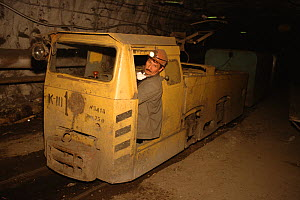 Driver in the cab of an underground train in the October Mine near Norilsk. Western Siberia, Russia, 2000.  -  Bryan and Cherry Alexander
