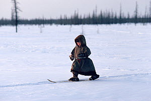 Nenets boy learning to ski. Yamal, Siberia, Russia, 1993. - Bryan and Cherry Alexander