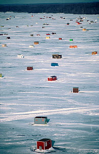 Ice-fishing huts on Mille Laks Lake. Minnesota, USA, 1985. - Bryan and Cherry Alexander